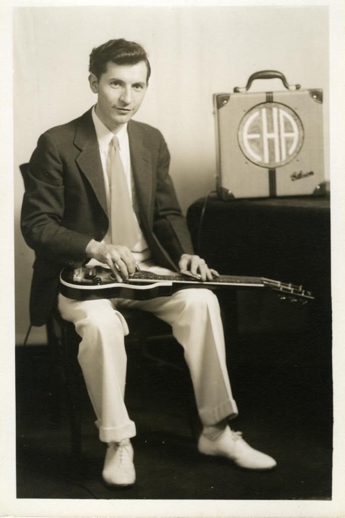 Eddie Alkire, seated, holding the Lap model EHarp.